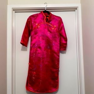 A pink, shiny costume dress.